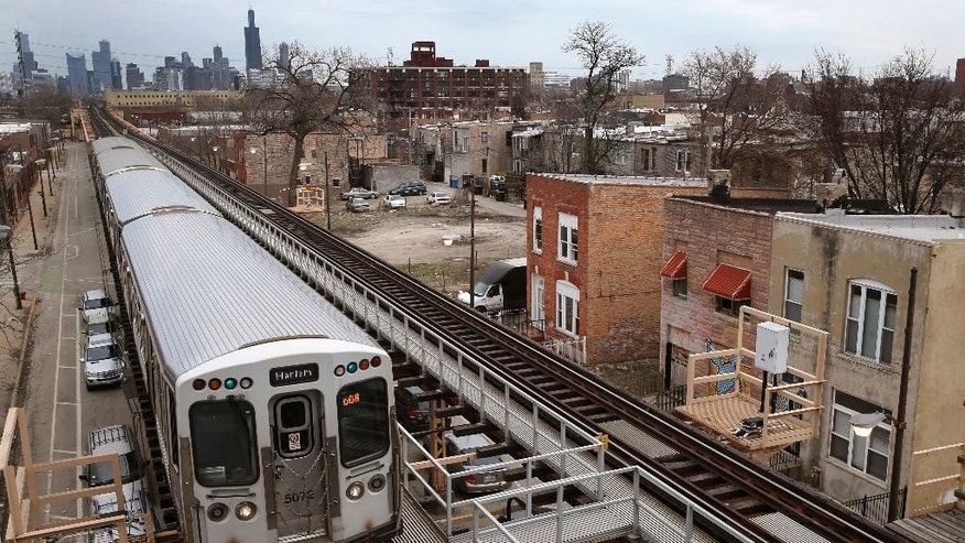 A Chicago Transit Authority Green Line train travels West away from downtown Chicago, Thursday, March 23, 2017, in Chicago. Census data shows the Chicago region has lost more residents than any other U.S. metropolitan area, a drop that comes as other Midwestern cities lost population and South and Southwest parts of the country saw gains. (AP Photo/Charles Rex Arbogast)