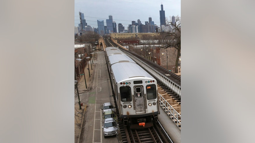 A Chicago Transit Authority Green Line train travels West away from downtown Chicago, Thursday, March 23, 2017, in Chicago. Chicago had the biggest population drop among major metropolitan areas, according to new Census data, part of a years-long decline for the region. (AP Photo/Charles Rex Arbogast)