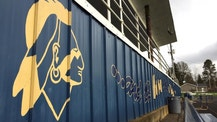 The Banks High School mascot is visible on the side of the football stands at the school in Banks, Ore., Thursday, March 23, 2017. In Oregon, school districts with Native American mascots must abandon them by July or risk punishment that could include the withholding of state funds. But with the approval of the state, a handful of districts are working with tribes to keep some version of their mascots in exchange for concessions, including better classroom lessons on the history and culture of the state's many tribes. (AP Photo/Gillian Flaccus)