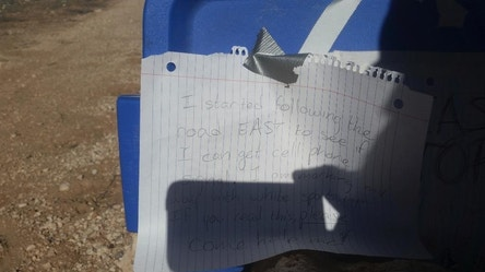 In this March 17, 2017, photo released by the Arizona Department of Public Safety shows a sign made by Amber VanHecke, who was stranded for five days near the Grand Canyon in Arizona. The 24-year-old Texas college student left signs on the car that ran out of gas detailing where she was headed in search of cell phone signal, and rescuers eventually found her. (Arizona Department of Public Safety via AP)