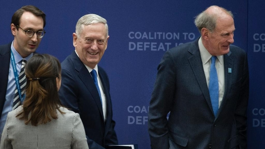 Defense Secretary Jim Mattis, center, and Director of National Intelligence Dan Coats, arrive to attend the Meeting of the Ministers of the Global Coalition on the Defeat of ISIS, Wednesday, March 22, 2017, at the State Department in Washington. Top officials from the 68-nation coalition fighting the Islamic State group are looking to increase pressure on the group as U.S.-backed forces move closer to retaking Mosul. (AP Photo/Cliff Owen)