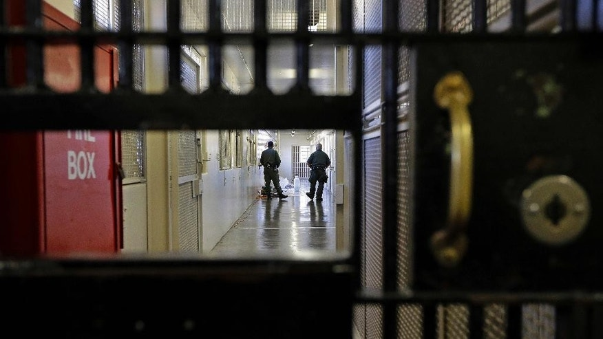 Guards at San Quentin State Prison's death row adjustment center.