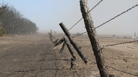 A five wire barbed wire fence eaten up by fire at the Scott Farm near Kingsdown, Kansas, March 7. A wildfire devestated the northern Clark County farmstead March 6. (Photo by Kylene Scott.)