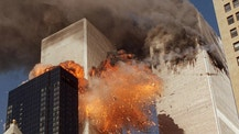 FILE - In this Sept. 11, 2001, file photo, smoke billows from one of the towers of the World Trade Center and flames as debris explodes from the second tower in New York. Family members of 9/11 families and others harmed in the terrorist attacks are on a fresh quest to hold Saudi Arabia responsible. A magistrate judge presiding over a Thursday, March 23, 2017, hearing says she hopes to streamline the legal process to speed the lawsuits along. (AP Photo/Chao Soi Cheong, File)