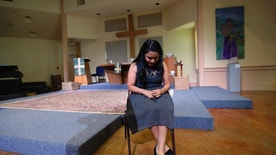 In this Wednesday, Feb. 22, 2017 photo, Hilda Ramirez, an immigrant living illegally in the U.S, sits in the sanctuary at St. Andrew's Presbyterian Church as she waits to talk to a reporter, Wednesday, in Austin, Texas. Ramirez, from Guatemala, and her son have taken refuge at the church for more than a year. (AP Photo/Eric Gay)