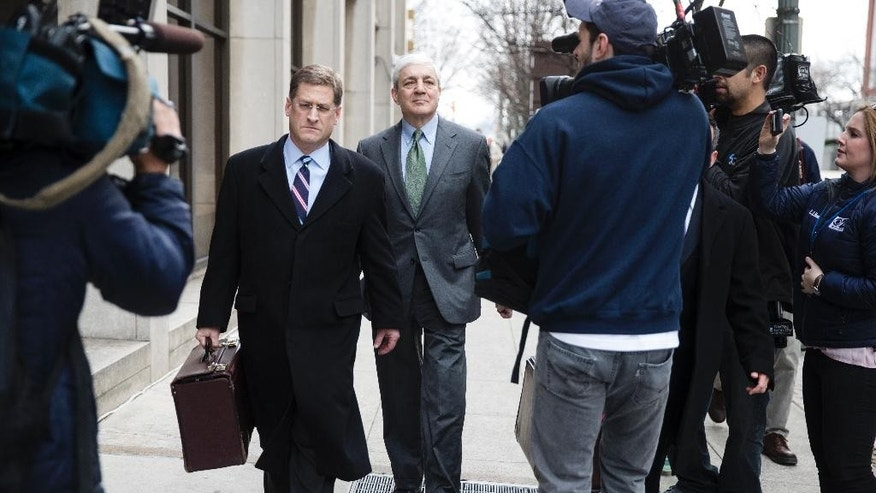 Former Penn State president Graham Spanier, center, walks with his attorney Sam Silver, center left, from the Dauphin County Courthouse in Harrisburg, Pa., Friday, March 24, 2017. Spanier was convicted Friday of hushing up suspected child sex abuse in 2001 by Jerry Sandusky, whose arrest a decade later blew up into a major scandal for the university and led to the firing of beloved football coach Joe Paterno. (AP Photo/Matt Rourke)