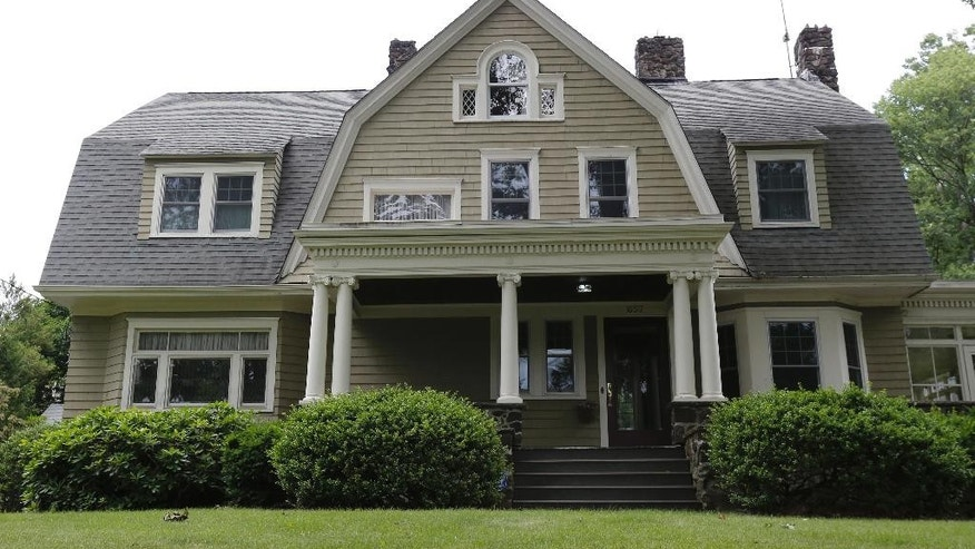 "FILE – In this June 25, 2015, file photo, the home of Derek and Maria Broaddus in Westfield, N.J. is viewed. The couple wants to demolish the house after they claim they were stalked by an anonymous creepy-letter writer known as ""The Watcher"" has filed a lawsuit against their town. (AP Photo/Julio Cortez, File)"