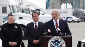 Homeland Security Secretary John Kelly speaks to the media at the Ambassador Bridge border crossing, Monday, March 27, 2017, in Detroit. Sen. Gary Peters D-Mich., center, and Director of Field Operations United States Customs and Border Protection Christopher Perry, left, listen. Kelly observed northern border operations and met with DHS personnel, local immigration stakeholders and Arab American community members. (AP Photo/Carlos Osorio)