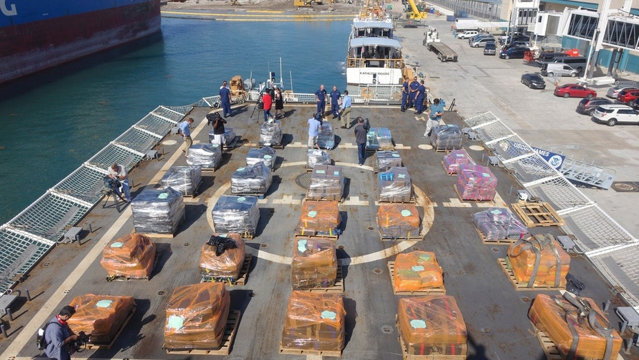 U.S. Customs and Border Patrol officers alongside Coast Guard personnel prepare to offload cocaine from the Coast Guard Cutter James, Tuesday, March 28, 2016, at Port Everglades in Fort Lauderdale, Fla.  The drugs were seized along Central and South America by the U.S. Coast Guard and the HMCS Saskatoon, which joined the operation in February.  (Joe Cavaretta/South Florida Sun-Sentinel via AP)