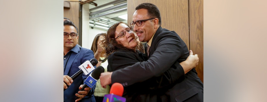 Marco Contreras, 41, right, is embraced by his mother, Maria Contreras, as his lawyers cheer following a Los Angeles court hearing during which he was declared factually innocent in Los Angeles on Tuesday, March 28, 2017. Contreras, whose attempted-murder conviction was tossed by a California judge, walked free Tuesday after 20 years in prison. (AP Photo/Damian Dovarganes)