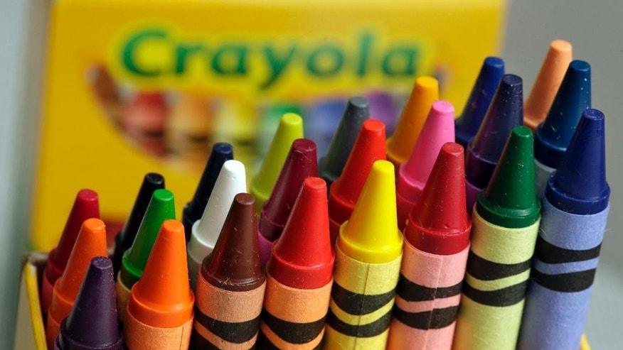 A 24-count box of Crayola crayons are shown, Tuesday, March 28, 2017, in New York. On National Crayon Day, Friday, March 31, Crayola is scheduled to announce the retirement of a color from the pack during an event in New York's Times Square. (AP Photo/Richard Drew)
