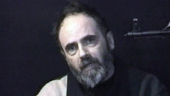 FILE - In this file image taken from insurgents video, released on Jan. 25, 2005, a man who identifies himself as American Roy Hallums pleads for Arab rulers to intercede to spare his life. Three Iraqis living in the U.S. as refugees have been charged with visa fraud after prosecutors say they hid their family ties to a kidnapper tied to the 2004 kidnapping of U.S. contractor Roy Hallums, who spent nearly a year in captivity before he was freed in an Army raid. (AP Photo/APTN-File) ** TV OUT **