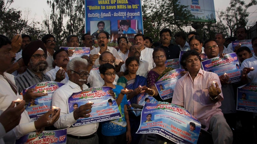 Parents of Indians living abroad are joined by others to participate in a candlelight vigil to pay their tributes to Srinivas Kuchibhotla in Hyderabad, India, Thursday, March 9, 2017.