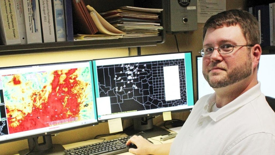National Weather Service hydrologist Royce Fontenot poses for a photograph after discussing soil moisture levels, high temperatures and a lack of rain as reasons for flash drought during an interview in his office in Albuquerque, N.M., on Tuesday, March 28, 2017. A quick uptick in temperatures and no precipitation combined for a flash drought over part of New Mexico in March. (AP Photo/Susan Montoya Bryan)