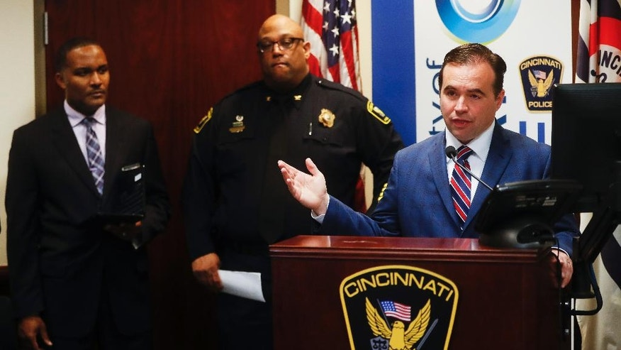 Cincinnati Mayor John Cranley speaks alongside police chief Eliot Isaac, center, and assistant fire chief Roy Winston, left, during a news conference at police headquarters regarding a fatal shooting at the Cameo club, Sunday, March 26, 2017, in Cincinnati. (AP Photo/John Minchillo)
