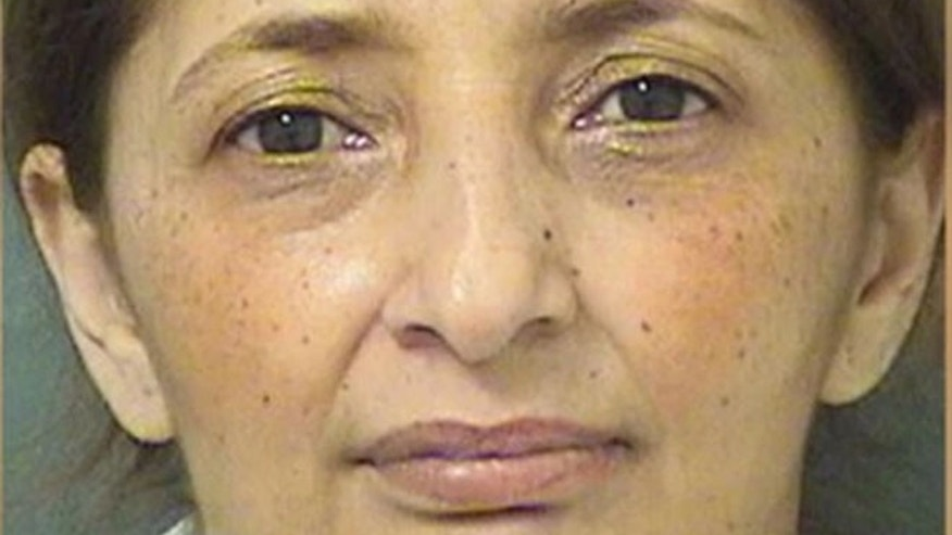 Fatima Milanovic, 46, allegedly tried to dupe the owner of ECJ Luxe Collection in Boca Raton