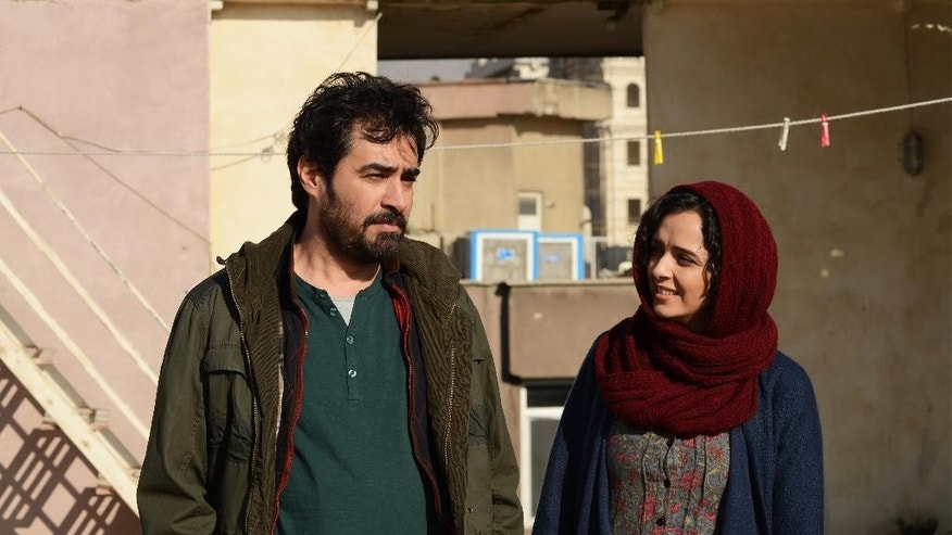 "This image released by Cohen Media group shows Shahab Hosseini, left, and Taraneh Alidoosti in a scene from ""The Salesman."" The film won an Oscar for best foreign language film at the 89th Academy Awards on Feb. 26. Movie theaters nationwide are programming with politics in mind.  In May, a coalition has formed to play films from the predominantly Muslim countries targeted by Donald Trump's travel ban. (Cohen Media Group via AP, File)"