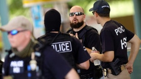 FILE: August 17, 2013: ICE Homeland Security Investigations agents during an investigation in Phoenix, Ariz .