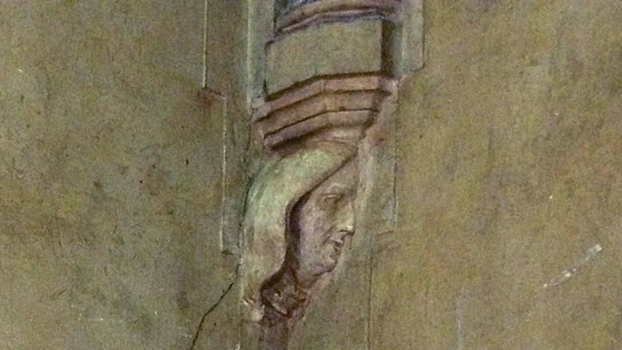In this undated photo provided by St. Mary's Church, the carved figure of a woman's face is visible on a wall in the church in Newport, R.I.