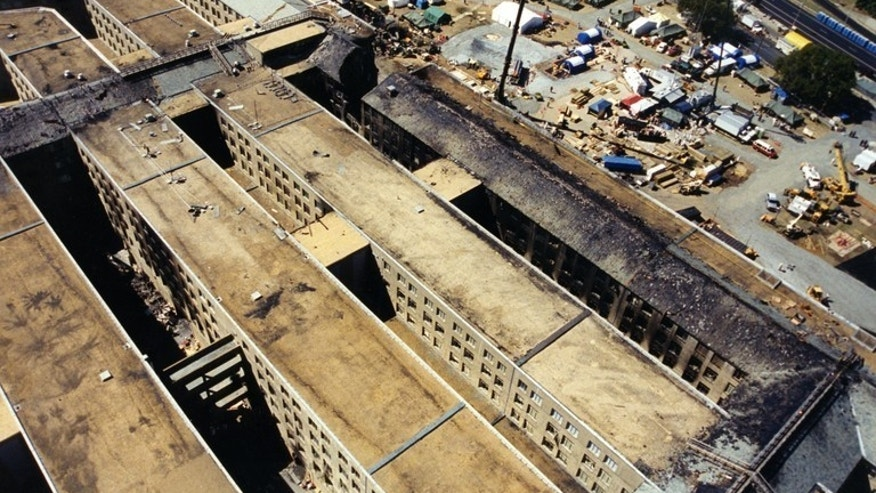 This undated photo provided by the FBI shows damage to the Pentagon caused during the 9/11 attacks. The FBI released a group of photos on March 30, 2017, showing the aftermath of the hijacked American Airlines Flight 77 crash into the Pentagon. (FBI via AP)