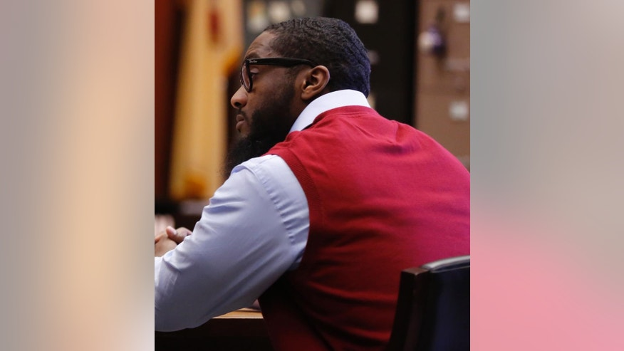 Basim Henry sits at the defense table as the jury hearing his case continues to deliberate for the second day Thursday, March 30, 2017, Newark, N.J. Henry is one of four men charged in the death of Dustin Friedland. The 30-year-old attorney from Hoboken, Friedland, was returning to his Range Rover in the mall parking garage with his wife, who was unharmed. (Bob Sciarrino/NJ Advance Media via AP, Pool)