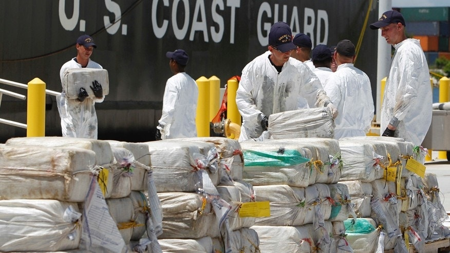 "FILE - In this Aug. 2, 2011 file photo, U.S. Coast Guard crew members unload roughly 7.5 tons of cocaine, in Miami Beach, Fla., which was seized from a submarine-like craft off the Caribbean Coast of Honduras. During President Porfirio ""Pepe"" Lobo Sosa's 2010-2013 administration, Honduras had deteriorated into violent upheaval. In 2011, the U.N. ranked it as the country with the world's highest murder rate. The U.S. State Department described it as ""primary transshipment point"" for U.S.-bound cocaine. (AP Photo/Lynne Sladky, File)"