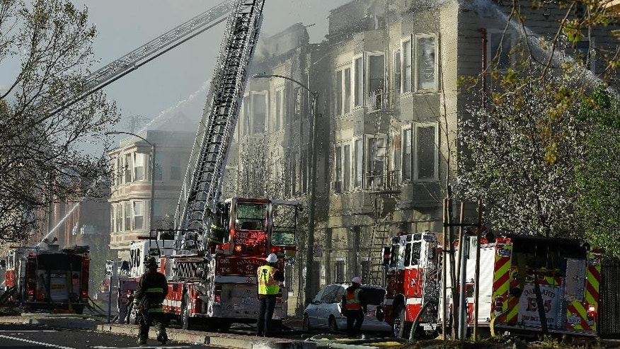 FILE - In this Monday, March 27, 2017 file photo, firefighters battle an early morning apartment fire in Oakland, Calif. Oakland officials say that a burning candle started a deadly building fire that killed four people. The announcement Thursday, March 30, 2017, rules out arson as the cause of a Monday blaze that also displaced dozens of residents in a building for recovering addicts and people who had been homeless. (AP Photo/Ben Margot, File)