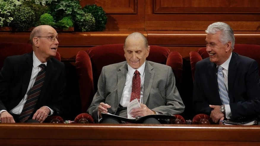 The Church of Jesus Christ of Latter-day Saints President Thomas S. Monson, center, First Counselor Henry B. Eyring, left, and Second Counselor Dieter F. Uchtdorf, right, look on during the morning session of the two-day Mormon church conference Saturday, April 1, 2017, in Salt Lake City. Mormons will hear guidance and inspiration from the religion's top leaders during a church conference this weekend in Salt Lake City as well as getting an update about church membership statistics. (AP Photo/Rick Bowmer)