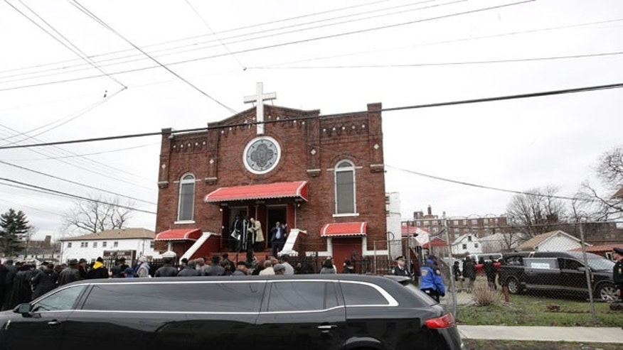 People attend the funeral services for Timothy Caughman Saturday, April 1, 2017, in New York. Caughman was alone and collecting bottles for recycling last month when he was attacked from behind with a sword.  Authorities say his assailant, James Harris Jackson, took a bus last month to New York to target black men.  Jackson is being held without bail on charges of murder as a hate crime.   (AP Photo/Frank Franklin II)
