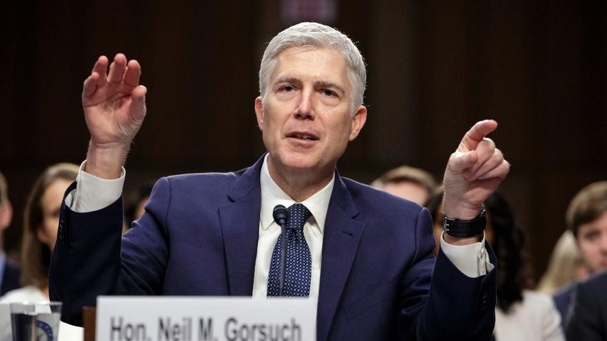 FILE - In this March 22, 2017, file photo, Supreme Court Justice nominee Judge Neil Gorsuch testifies on Capitol Hill in Washington, at his confirmation hearing before the Senate Judiciary Committee. The Senate is headed for a tense showdown over President Donald Trump's Supreme Court nominee that could have far-reaching consequences for Congress, the high court and the nation. (AP Photo/J. Scott Applewhite, file)