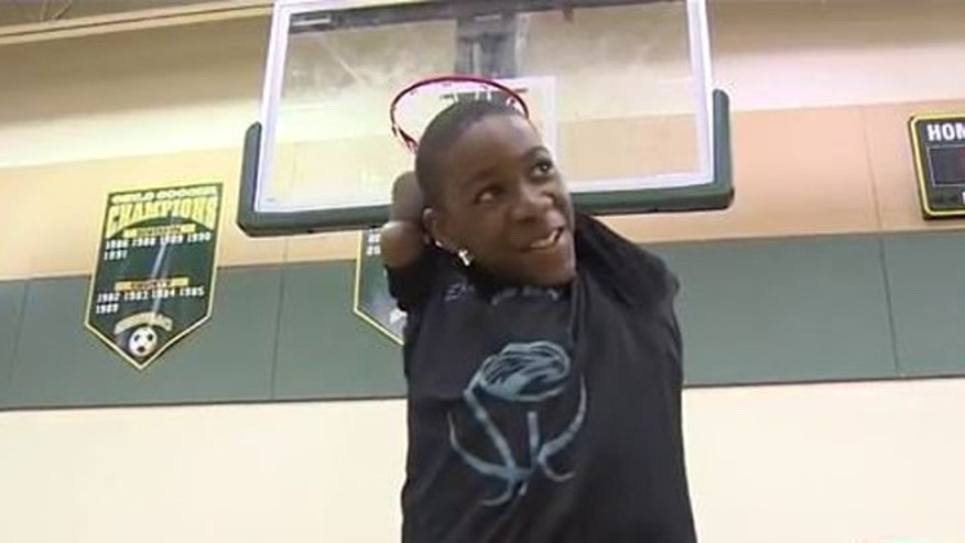 Armless middle school basketball player Jamarion Styles, 13, on the court at Eagles Landing Middle School in Boca Raton, Fla.