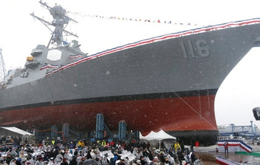 The future USS Thomas Hudner, a U.S. Navy destroyer named after Korean War veteran Thomas Hudner, looms over the audience during a christening ceremony at Bath Iron Works in Bath, Maine, Saturday, April 1, 2017.  Hudner, a naval aviator who crash-landed his plane to try to save a downed pilot in the Korean War was honored with a ship bearing his name. (AP Photo/Mary Schwalm)
