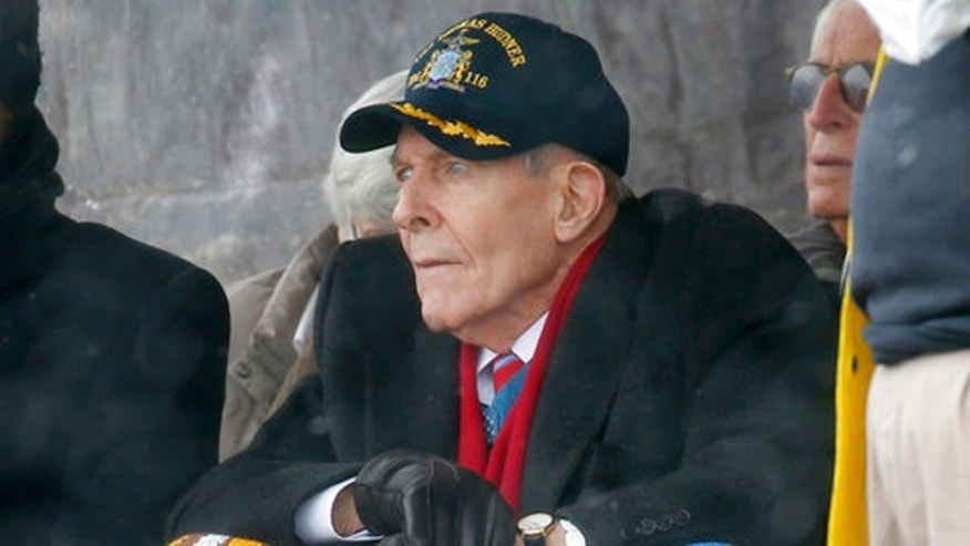 Korean War veteran Thomas Hudner looks on during the christening ceremony for the future USS Thomas Hudner, a U.S. Navy destroyer named in his honor, at Bath Iron Works in Bath, Maine, Saturday.