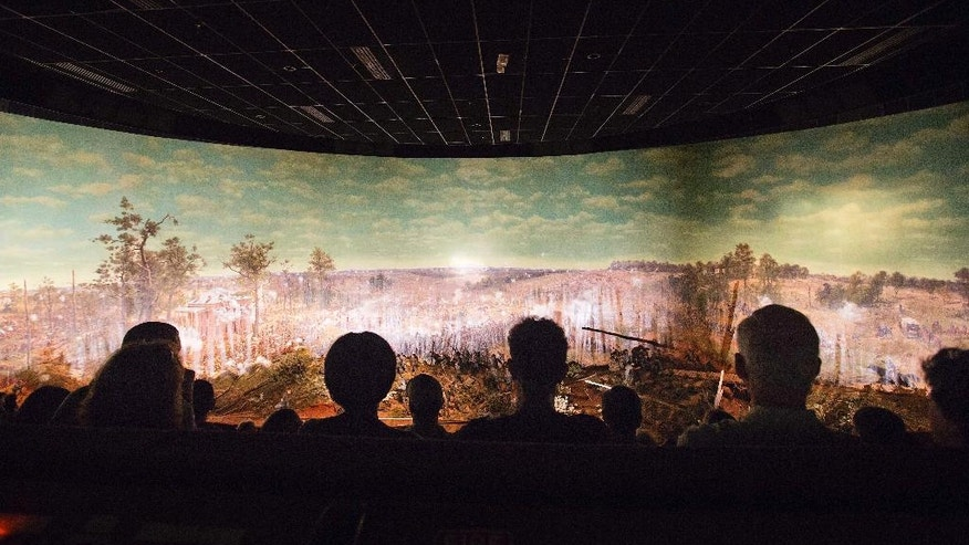 FILE - In this Tuesday, June 30, 2015, file photo, visitors view the Atlanta Cyclorama, the colossal Civil War painting, in Atlanta. The Atlanta History Center is restoring the 150,000-square-foot, cylindrical panorama painting, which will go in display in 2018. (AP Photo/David Goldman, File)