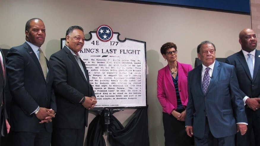 The Rev. Jesse Jackson, second from left, and Andrew Young, second from right, pose for photos after the unveiling of a historical marker at Memphis International Airport commemorating the final flight of slain civil rights leader Martin Luther King Jr. on Monday, April 3, 2017 in Memphis, Tenn. Also pictured are Operation Hope founder and CEO John Hope Bryant, far left, SunTrust Bank executive Johnny Moore, far right, and Memphis-Shelby County Airport Authority board member Pamela Clary, third from right. (AP Photo/Adrian Sainz).