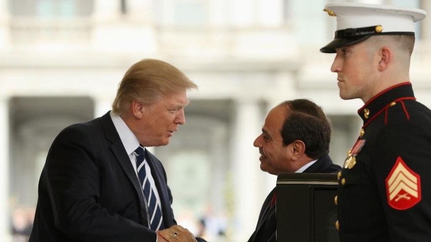 President Donald Trump greets Egyptian President Abdel Fattah Al-Sisi as he arrives at the White House in Washington, Monday, April 3, 2017. (AP Photo/Andrew Harnik)