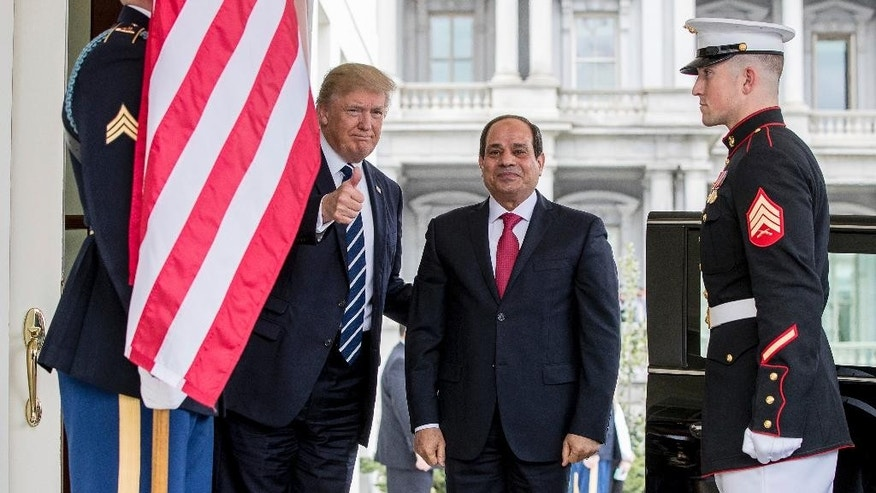 President Donald Trump gives a thumbs up to members of the media as he greets Egyptian President Abdel Fattah Al-Sisi at the White House in Washington, Monday, April 3, 2017. (AP Photo/Andrew Harnik)