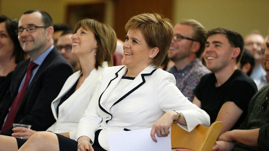 "Scotland's First Minister Nicola Sturgeon smiles during her introduction before giving a speech at Stanford University Tuesday, April 4, 2017, in Stanford, Calif. Sturgeon delivered a speech about ""Scotland's Place in the World"" before heading to New York. (AP Photo/Eric Risberg)"