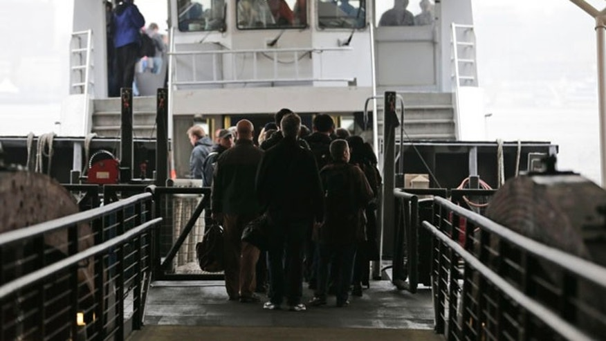 Commuters board a ferry bound for lower Manhattan in Hoboken, N.J., Tuesday, April 4, 2017. A minor derailment on Monday at Penn Station involving a New Jersey Transit train and other rail issues are causing major problems for New York City metro area commuters. (AP Photo/Seth Wenig)