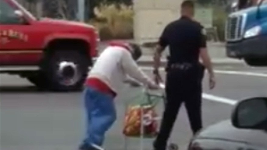 An Anaheim police officer is being praised for helping a woman cross the street.