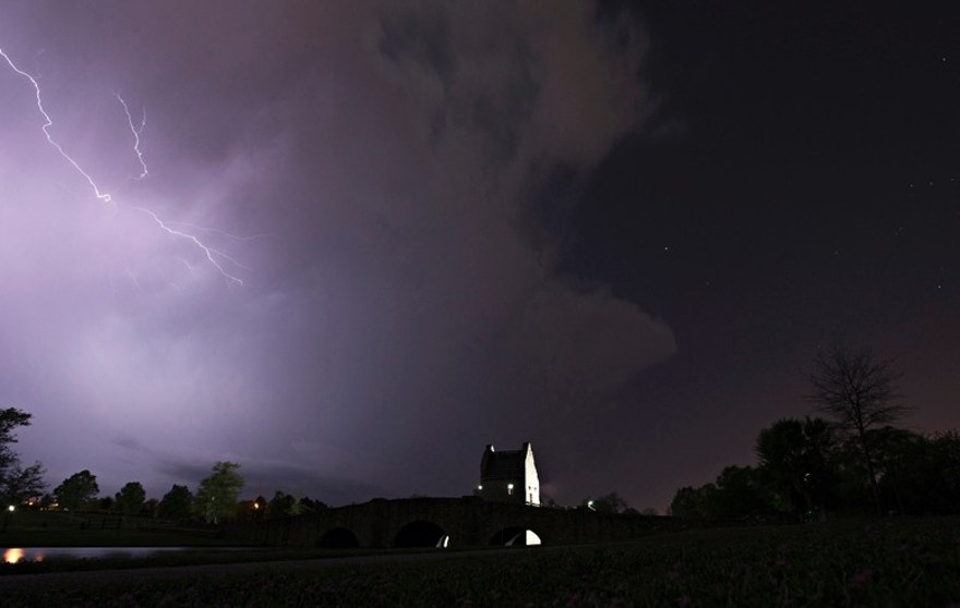 Lightning runs through cloud over Blount Cultural Park in Montgomery, Ala., Wednesday, April 5, 2017, as a thunderstorm moves through southern Montgomery County. A powerful tornado toppled trees and downed power lines in rural Georgia and similar scenes played out in spots around Alabama and South Carolina amid drenching rain, high winds and scattered hail - some as big as baseballs. (Albert Cesare/The Montgomery Advertiser via AP)