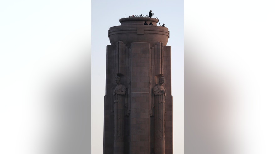 "Workers prepare for ceremonies from top of the nation's official WWI monument, Liberty Memorial, in Kansas City, Mo., Thursday, April 6, 2017. Foreign dignitaries from around the world are converging on Kansas City and its towering World War I monument to observe the 100th anniversary of the day the U.S. entered ""The Great War."" (AP Photo/Orlin Wagner)"