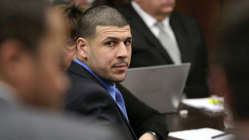 Former New England Patriots tight end Aaron Hernandez is seated during closing arguments in his trial at Suffolk Superior Court, Thursday, April 6, 2017, in Boston. Hernandez is on trial for the July 2012 killings of Daniel de Abreu and Safiro Furtado who he encountered in a Boston nightclub. The former NFL player is already serving a life sentence in the 2013 killing of semi-professional football player Odin Lloyd. (AP Photo/Steven Senne, Pool)