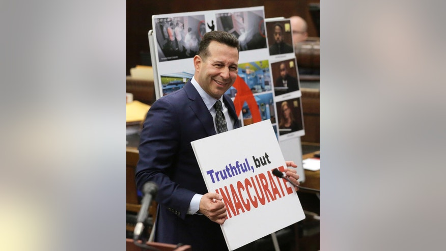 Defense attorney Jose Baez holds a placard while presenting closing arguments in the trial of former New England Patriots tight end Aaron Hernandez, at Suffolk Superior Court, Thursday, April 6, 2017, in Boston. Hernandez is on trial for the July 2012 killings of Daniel de Abreu and Safiro Furtado who he encountered in a Boston nightclub. The former NFL player is already serving a life sentence in the 2013 killing of semi-professional football player Odin Lloyd. (AP Photo/Steven Senne, Pool)