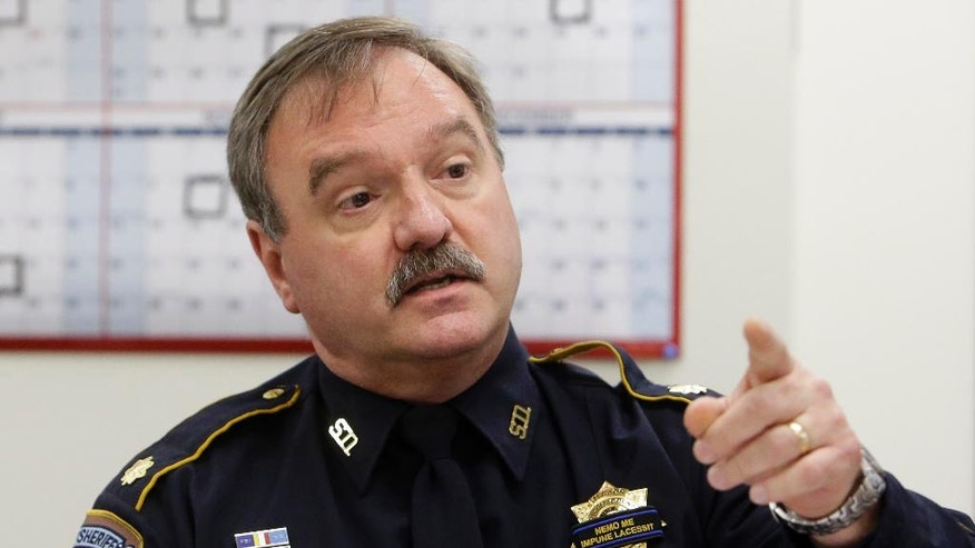 In this Thursday, July 21, 2016, photo, Harris County Sheriff's Office Maj. Clint Greenwood answers questions during a civil service commission, in Houston. Harris County Precinct 3 Assistant Chief Deputy Greenwood was shot and killed Monday, April 3, 2017, moments after arriving for work. (Melissa Phillip/Houston Chronicle via AP)