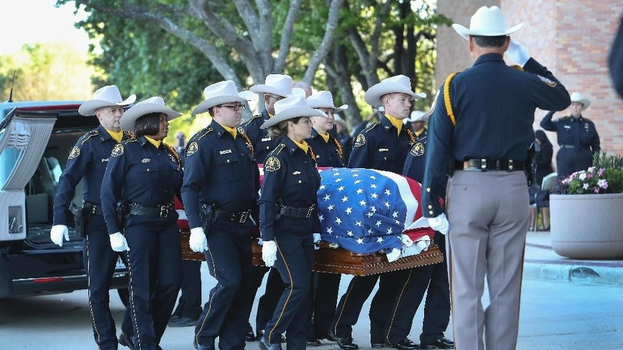 The body of Harris County assistant chief deputy constable Clint Greenwood arrives at the Second Baptist Church on Thursday, April 6, 2017, in Houston.  Greenwood was killed Monday by a gunman who stepped out from behind a dumpster as Greenwood arrived for work at a county courthouse east of Houston. The gunman is still on the run.  (Steve Gonzales/Houston Chronicle via AP)