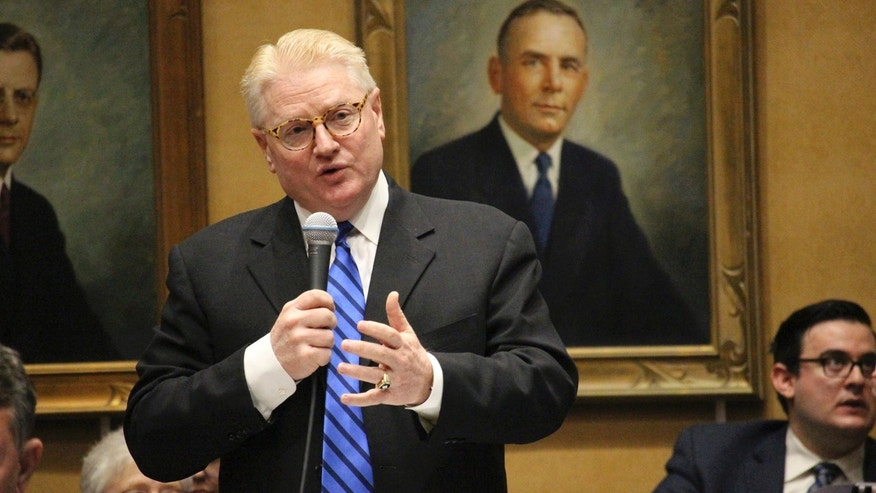 Republican state Sen. Bob Worsley, standing, explains a deal he negotiated to cap overall growth in a proposal expanding Arizona's private school voucher program to all students Thursday, April 6, 2017, in Phoenix. (AP Photo/Bob Christie)