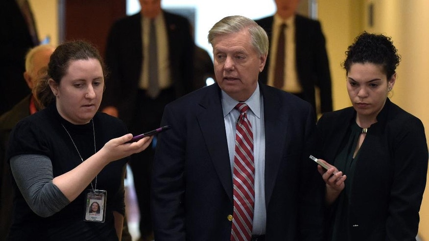 Sen. Lindsey Graham, R-S.C., center, speaks to reporters following a briefing on Syria on Capitol Hill in Washington, Friday, April 7, 2017. (AP Photo/Susan Walsh)