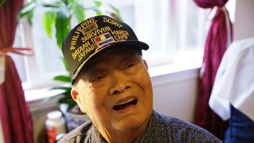 In this photo taken Thursday, April 6, 2017, Bataan Death March survivor Ramon Regalado reminisces at his home in El Cerrito, Calif. Survivors of the infamous Bataan Death March in the Philippines are marking the anniversary in San Francisco with speeches and a 21-gun battery salute for the thousands who died during the march. Among the speakers will be Regalado, a former wartime machine-gun operator who turns 100 this month and is among the war's few living survivors. (AP Photo/Eric Risberg)