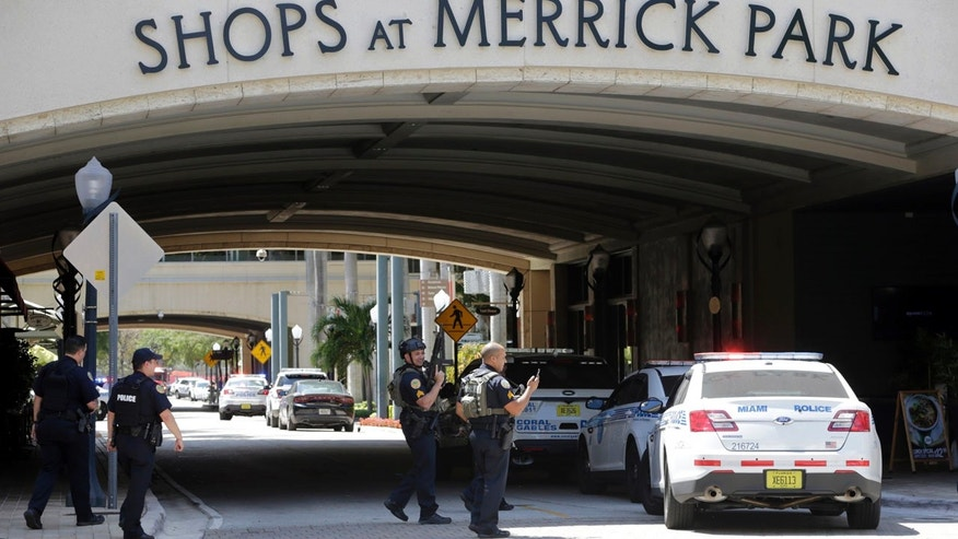 Police patrol outside of the Shops at Merrick Park after a shooting,Saturday, April 8, 2017, in Coral Gables, Fla.   Alvaro Zabaleta of the Miami-Dade Police Department says detectives have responded to the scene of the shooting in the upscale shopping mall in South Florida.  (AP Photo/Lynne Sladky)